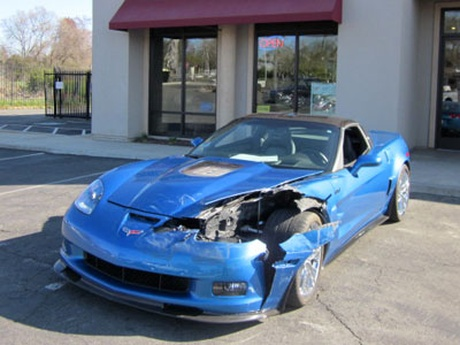 Exotic sports car with body dmaage before repair work by Vice's Collision Repair